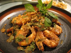 Satay shrimps with salted egg yolks and basil
