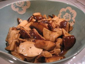 Stir fried mix mushrooms with pickled cucumber